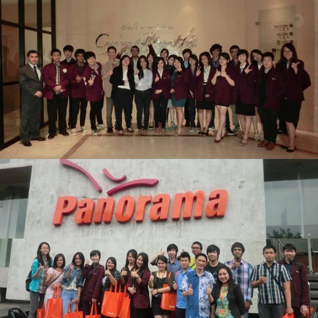 Tourism stream students pose in and out of panorama Tour office